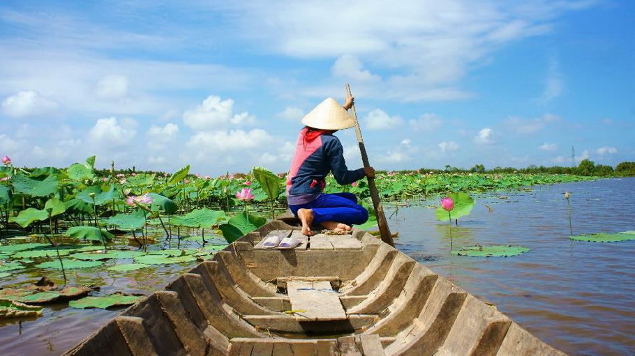 http://fotos.hellotrip.es/vietnam/Vietnam_Delta_Mekong_canoa.jpg